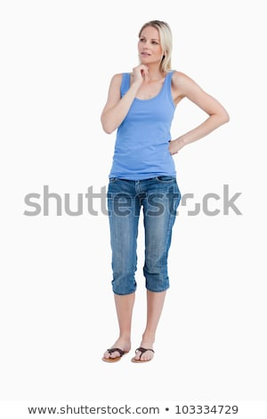 young woman standing with her hand on hip with her fingers cross stock photo © bmonteny