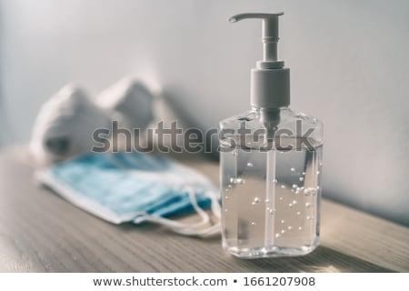mão · garrafa · verde · líquido · plástico · objeto - foto stock © dezign56