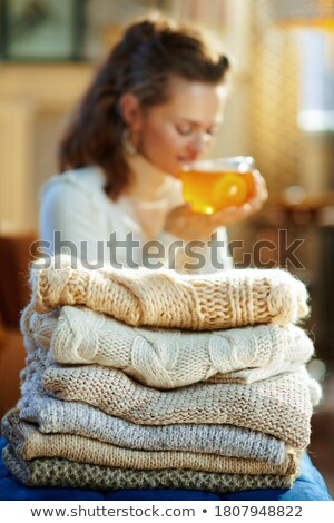 Woman Enjoying Knitting Garment At Home Stock photo © HighwayStarz