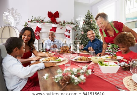 Father serving Christmas meal to family Stock photo © wavebreak_media
