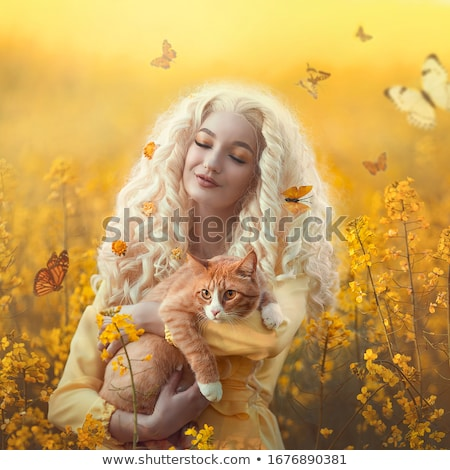 fantasy dreamy woman in meadow with butterflies stock photo © gromovataya