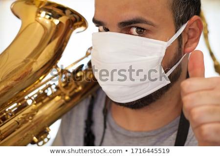 Saksofon muzyk mężczyzna Zdjęcia stock © JamiRae