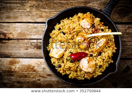 pilaf in a pig iron frying pan stock photo © zoryanchik