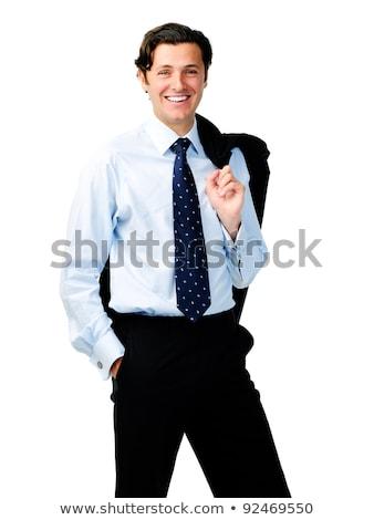 Businessman standing with jacket on shoulder  Stock photo © deandrobot
