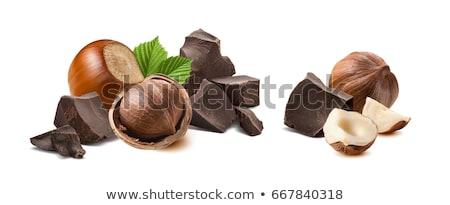 Chocolate with hazelnuts Stock photo © joannawnuk