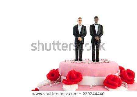 Esküvői torta homoszexuális pár rózsaszín vörös rózsák felső Stock fotó © ivonnewierink