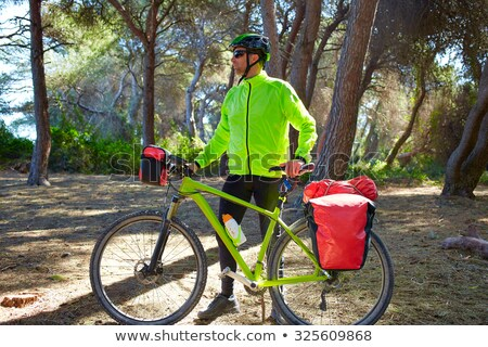 MTB Biker Bicycle touring in a pine forest Stock photo © lunamarina
