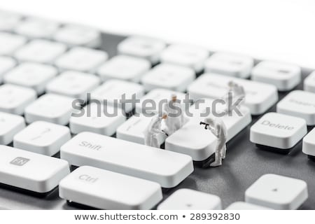 group of miniature criminalists inspecting computer keyboard cybercrime concept stock photo © kirill_m