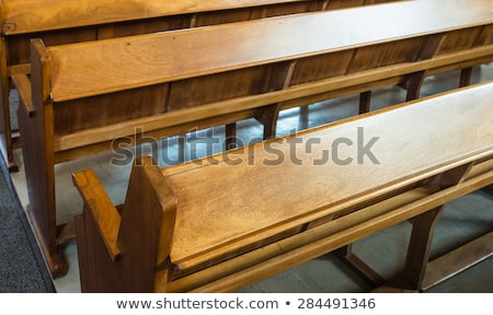 Rows of wooden church benches without anybody from close Stock photo © Zhukow