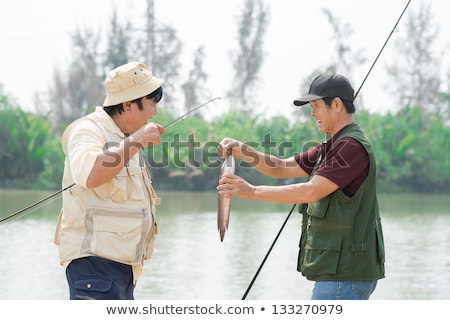 Fishermen hold their catch Stock photo © jrstock
