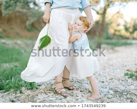 Stock foto: Pebbles In Family With Girl Hands