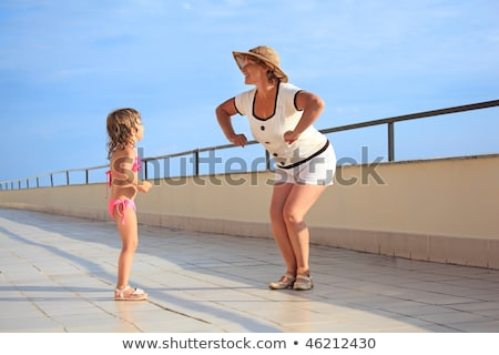 mature woman with little girl on veranda stock photo © paha_l