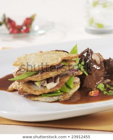 Stock photo: Venison and potato pancakes