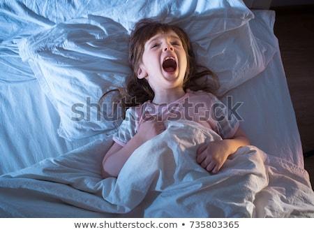 Notte terrore spaventato giovane ragazza letto nascondere Foto d'archivio © AlienCat
