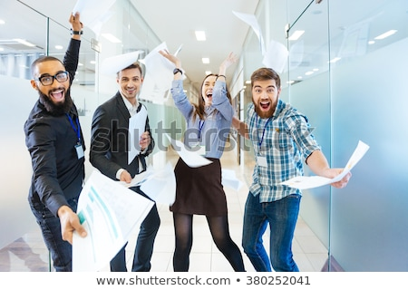group of joyful excited business people having fun in office stock photo © deandrobot