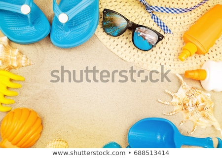 beach ready summer holiday vacation accessories on sandy beach stock photo © stevanovicigor