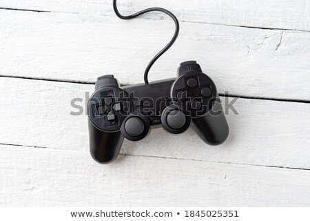 Gamepad controller on wooden desk, flat lay top view Stock photo © stevanovicigor