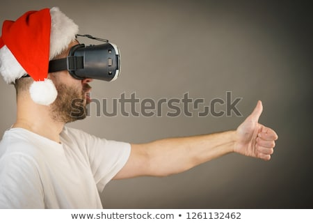 Man with VR goggles exploring virtual reality econtent Stock photo © stevanovicigor