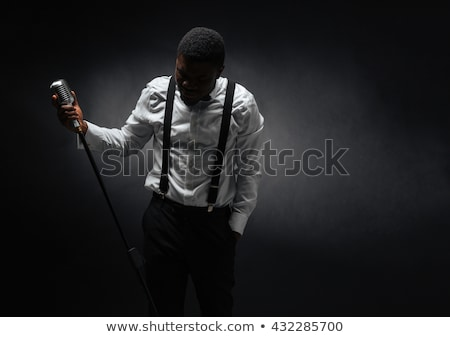 afro amerian man singing into vintage microphone stock photo © deandrobot