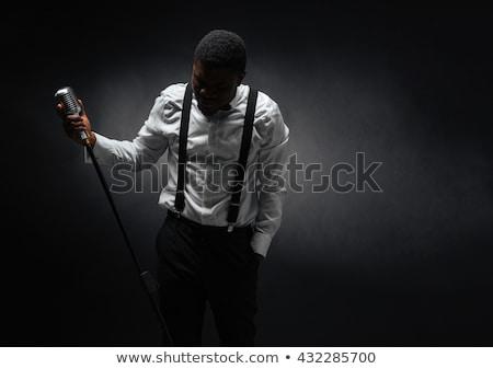 афро человека пения Vintage микрофона темно Сток-фото © deandrobot