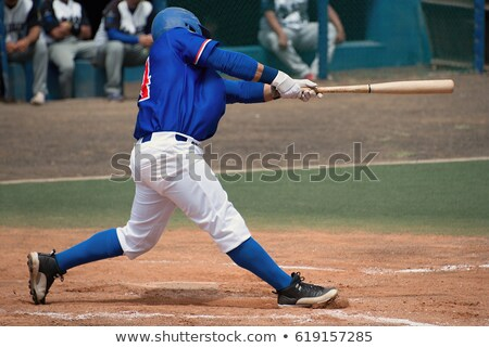 A baseball player with a blue uniform Stock photo © bluering