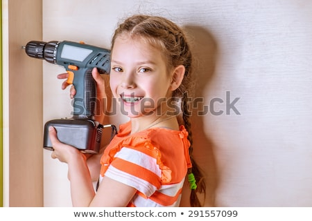 A young girl with drilling machine Stock photo © kalozzolak