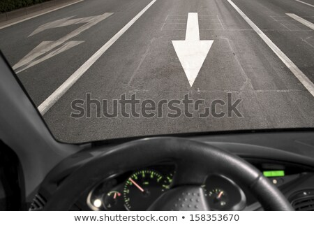 Driving car in wrong direction against traffic arrow sign Stock photo © stevanovicigor
