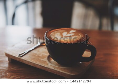 A cup of coffee or hot coffee on wooden table , soft-tone , focu Stock photo © Boophuket