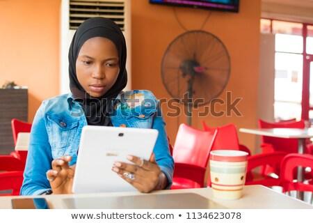 smiling girl in Internet cafe Stock photo © ssuaphoto
