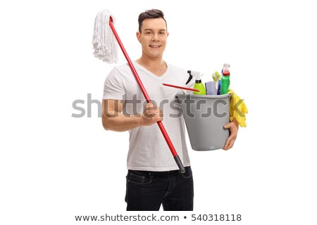 Man holding plastic bucket with bottles and brushes, gloves and  stock photo © Yatsenko