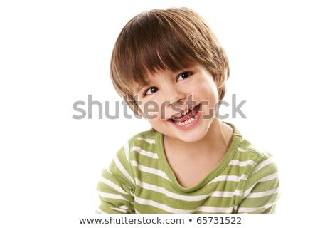sonriendo · cute · nino · estudio · cara · hombre - foto stock © meinzahn
