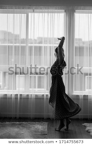Bailarina baile grande ventana pie Foto stock © O_Lypa