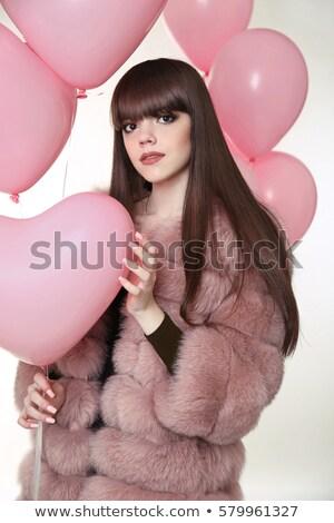 Foto stock: Attractive Brunette Girl With Long Healthy Hair In Fur Fox Coat