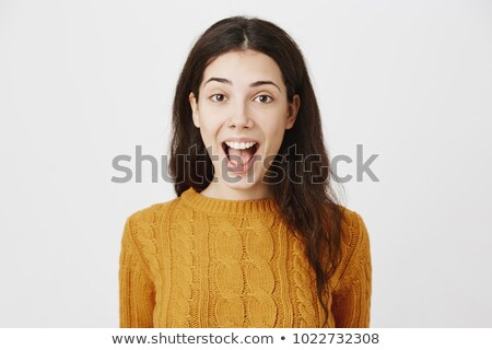 Portrait of an astonished cute girl standing with mouth opened Stock photo © deandrobot