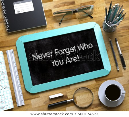 Never Forget Who You Are Concept on Small Chalkboard. 3D. Stock photo © tashatuvango