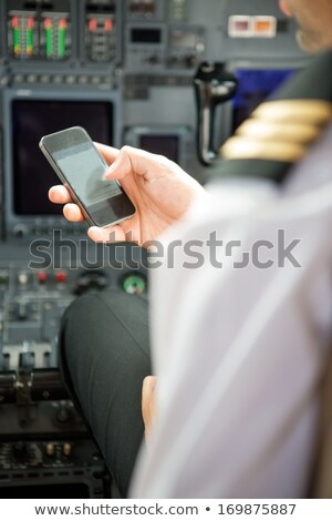 Flight captain using cell phone stock photo © IS2