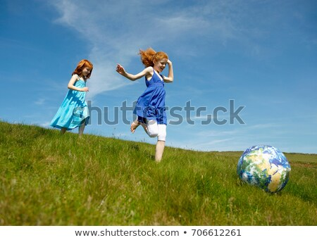 2 young girls running with ball globe stock photo © is2