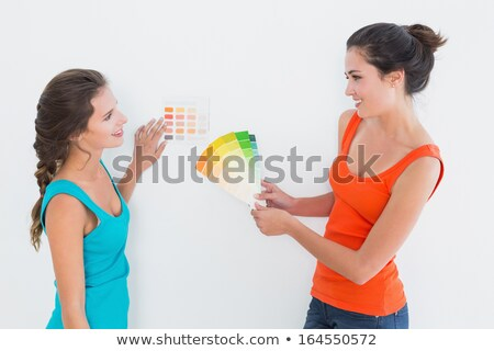 Two friends choosing paint colours Stock photo © IS2
