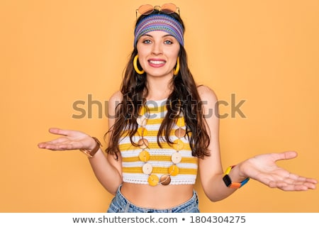 Hippie woman with arm out in a welcoming gesture Stock photo © RAStudio