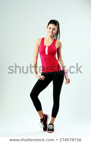 Full length portrait of an attractive muscular sportswoman Stock photo © deandrobot