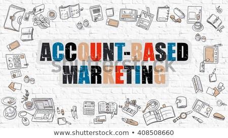 account based marketing concept multicolor on white brickwall stock photo © tashatuvango
