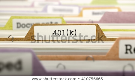 Folders in Catalog with 401K Concept. Stock photo © tashatuvango