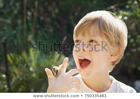 A headshot of a boy with a snail Stock photo © IS2