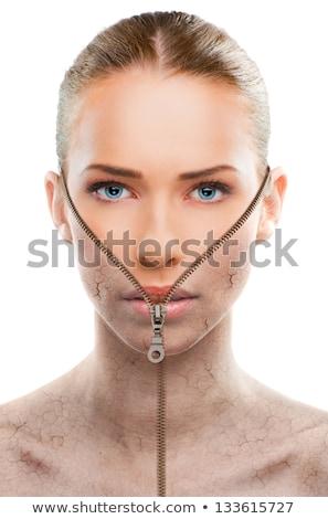 Gyönyörű fiatal nő cipzár arc közelkép portré Stock fotó © svetography