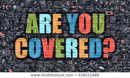 multicolor are you covered on dark brickwall doodle style stock photo © tashatuvango
