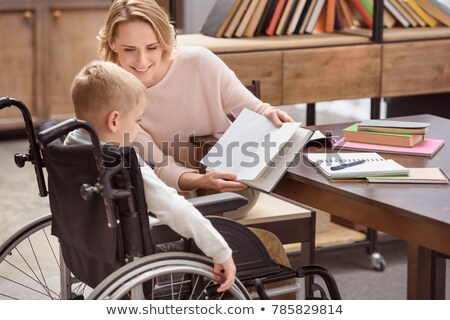 Kid Boy Wheelchair Books Mom Stock photo © lenm