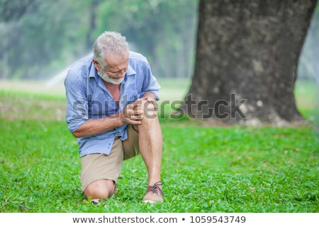 Senior woman having knee pain walking in park Stock photo © manaemedia