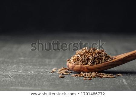 łyżka kminek nasion deska do krojenia full frame Zdjęcia stock © Digifoodstock