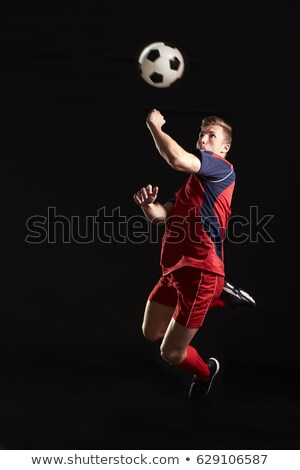Footballer mid air heading ball Stock photo © IS2