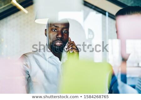 Africano barbudo empresário verificar lista negócio Foto stock © studioworkstock